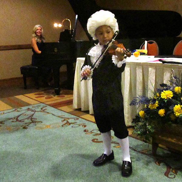 Iggy Rosado plays his piece The Spooky Lion in his Mozart costume